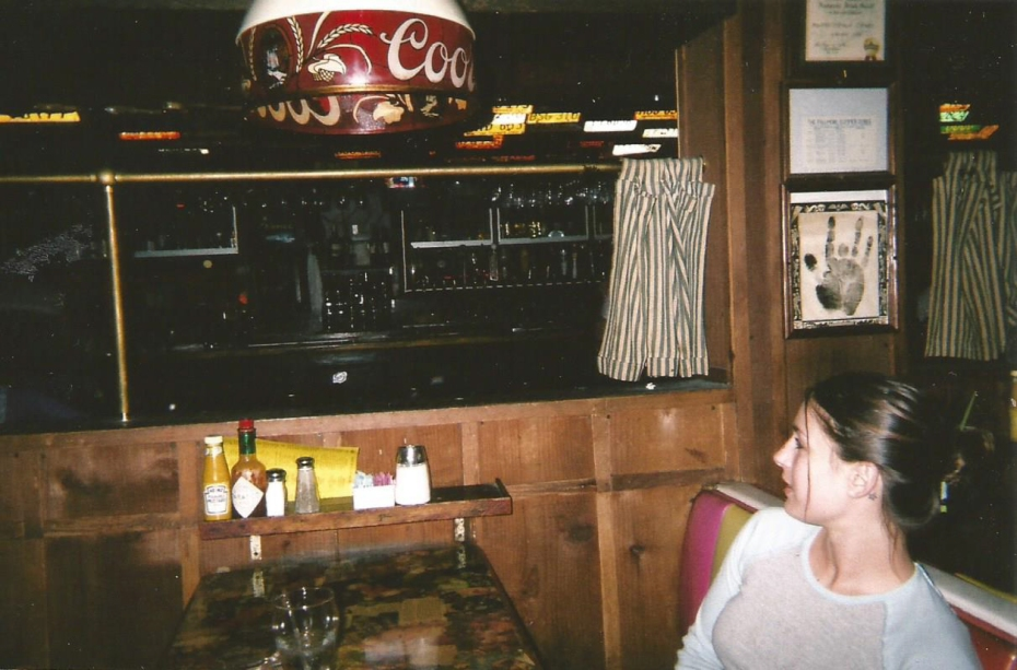 Inside Barney's Beanery. Pictured is the waitress who also played in the Paper Dolls.
