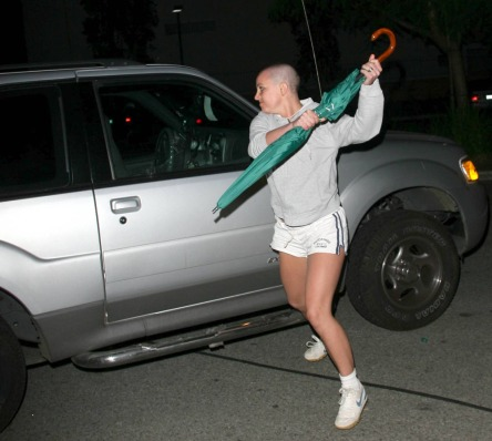 Britney busting a move with the infamous green umbrella. Hairdo courtesy B.S.